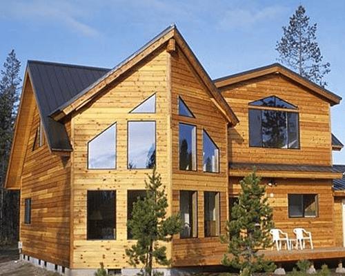 Дом облицованный имитацией бруса