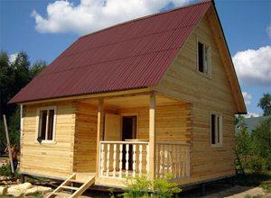 Фото дома из бруса с верандой
