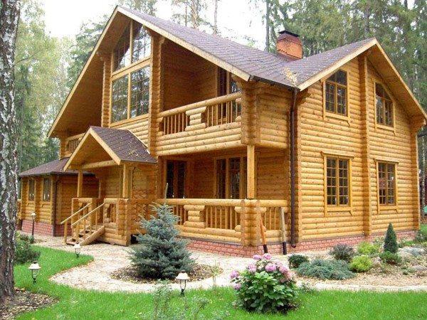 Фото дома из клееного дерева.