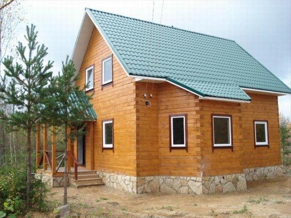 Фото брусового дома на фундаменте