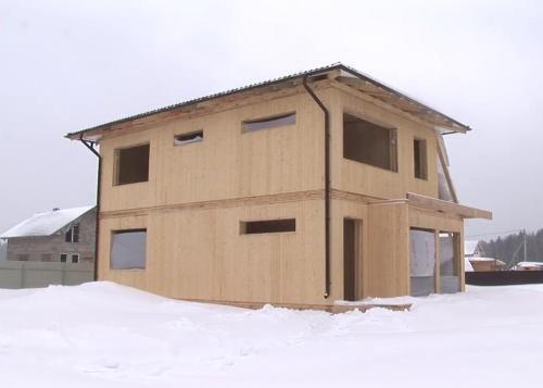 Фото дома из вертикального бруса