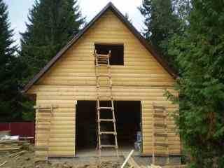 Фото дома построенного с использованием имитации брусьев.