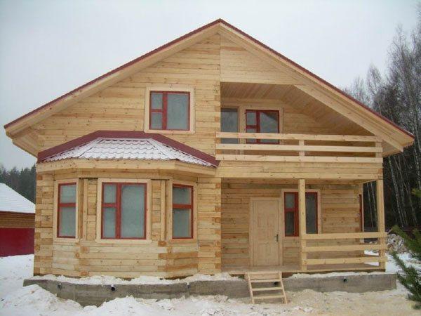 Фото дома с мансардой из бруса