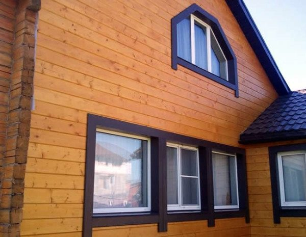 Фото имитации на фасаде дома