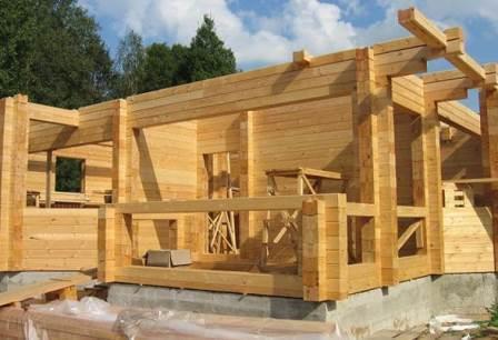 Фото строительства дома из бруса.